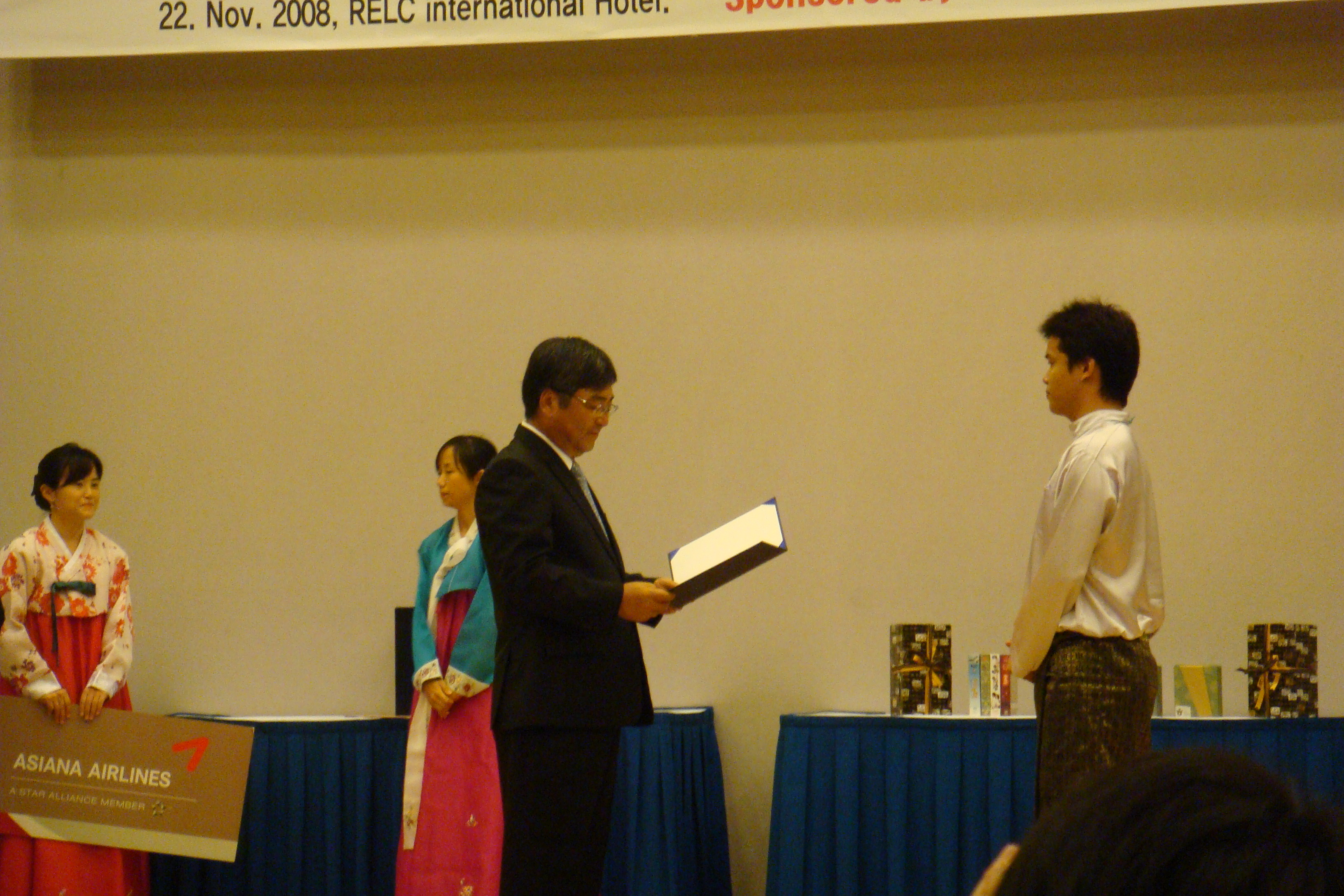 the winner taking his cert from the ambassador